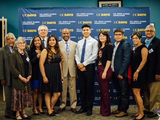 UC Davis Chicanx Latinx Alumni Association leaders pose with scholarship recipients and Chancellor Gary May
